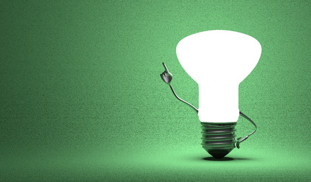aha: Glowing light bulb character in aha moment on green background Stock Photo