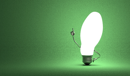 aha: Glowing ellipsoidal light bulb character in aha moment on green background