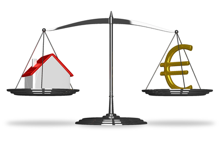 House and golden euro sign on scales isolated photo