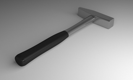 hobnail: Hammer with black handle lying on gray background