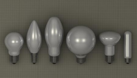 arbitrario: Varios blancas bombillas brillantes mienten en el fondo cuadrado gris Foto de archivo