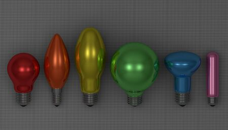 Various multicolor glossy light bulbs lying on gray squared background photo