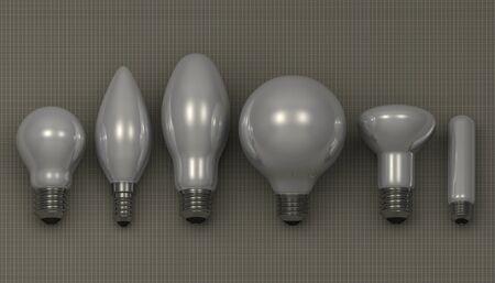 arbitrary: Varios blancas bombillas brillantes mentir sobre fondo cuadrado gris, vista frontal