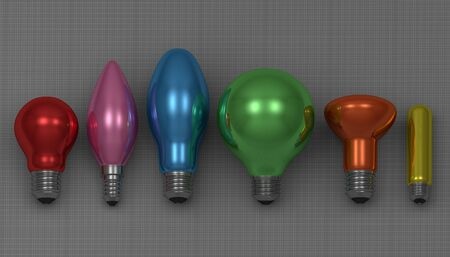 Various multicolor glossy light bulbs lying on gray squared background, front view photo
