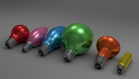 Various multicolor glossy light bulbs lying on gray squared background, perspective view photo