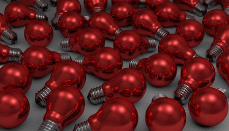 willekeurig: Veel willekeurige rood glanzend gloeilampen liggend op grijze kwadraat achtergrond Stockfoto