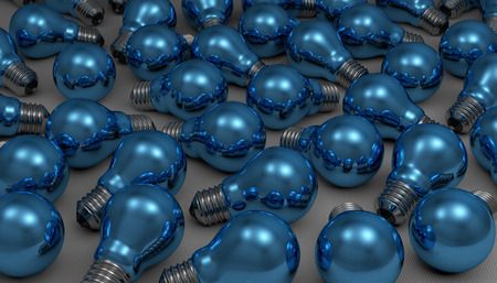 Many arbitrary blue glossy light bulbs lying on gray squared background Stok Fotoğraf