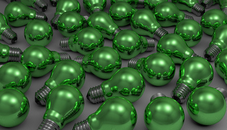 Many arbitrary green glossy light bulbs lying on gray squared background photo