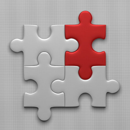 Connected white puzzle pieces and red one lying on gray background
