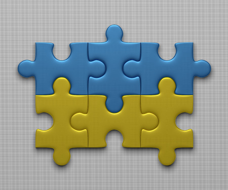 assembled: Ukrainian flag assembled of puzzle pieces on gray background Stock Photo