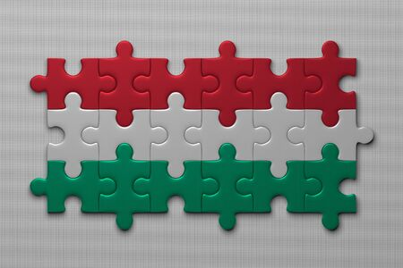 unitary: Hungarian flag assembled of puzzle pieces on gray background