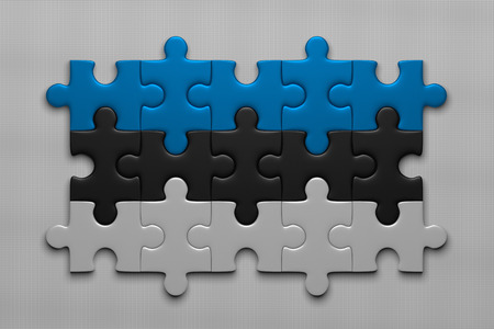 assembled: Estonian flag assembled of puzzle pieces on gray background
