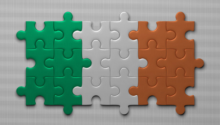 assembled: Irish flag assembled of puzzle pieces on gray background Stock Photo