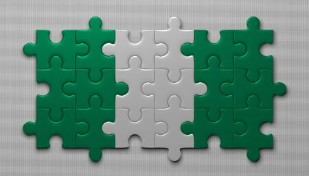 assembled: Nigeria flag assembled of puzzle pieces on gray background