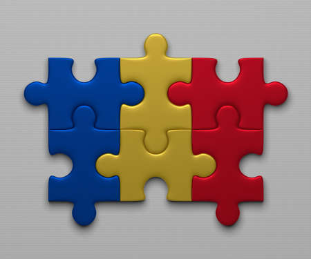 assembled: Romania flag assembled of puzzle pieces on gray background Stock Photo