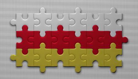 assembled: South Ossetia flag assembled of puzzle pieces on gray background