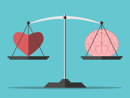 emotional: Heart and brain on scales.