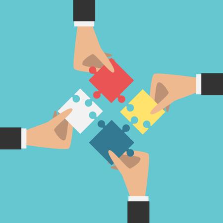 trabajo en equipo: Cuatro manos poniendo los pedazos múltiples rompecabezas de color juntos.