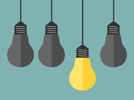 gray bulb: One unique bright glowing yellow light bulb among dull gray ones. Single shining lightbulb. Creativity, innovation, inspiration and success concept.