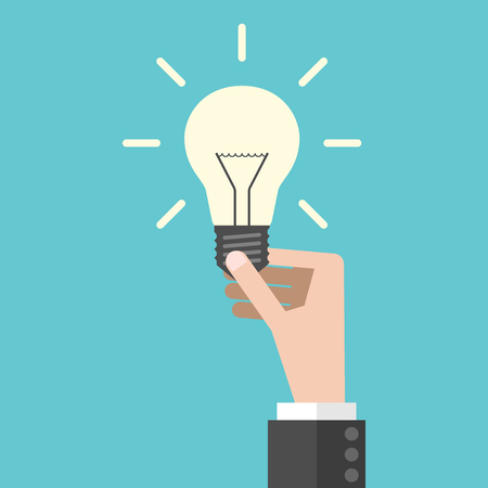 Hand holding bright shining light bulb. Innovation, insight and tip concept. Flat design. EPS 8 vector illustration, no transparency