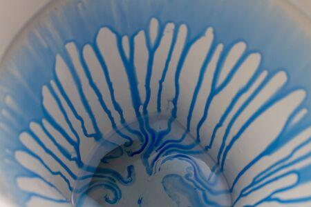 blue toilet cleaner on white sanitary ware
