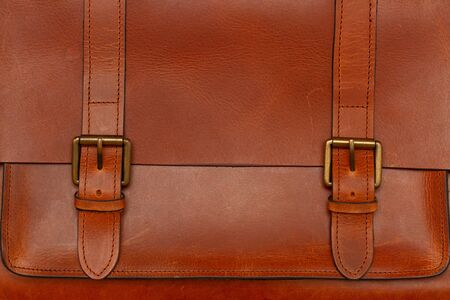 close-up of a leather brown briefcase with clasps