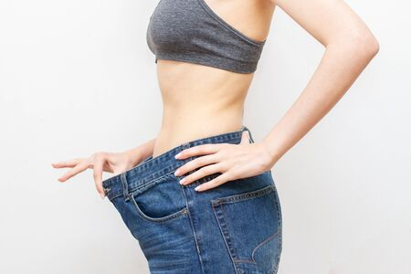 Woman In Oversize Pants after weight loss. Diet concept.