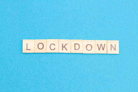 LOCKDOWN word from wooden blocks. New normal after covid-19 pandemic concenpt. Quarantine.