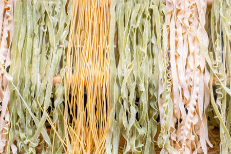 Background different varieties of raw Italian pasta