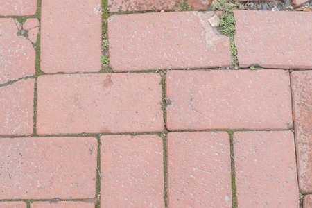 Red brick paving road texture background.