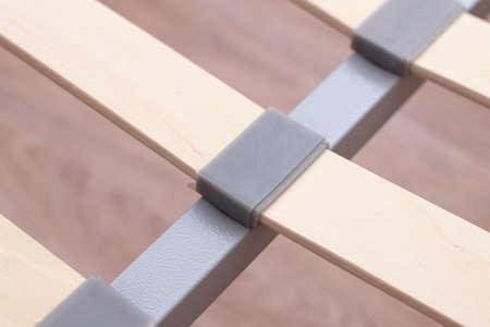 Bed frame. Wooden slats of a bed. Birchen an arthopedic base of a bed.