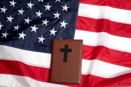 American flag and holy Bible with cross.