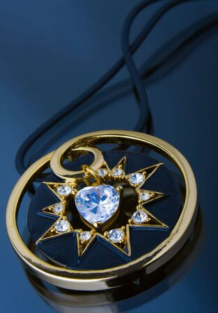 brilliants: brilliants and gold on dark blue background