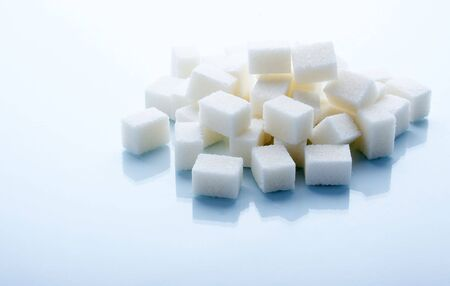 Sugar cubes on a blue background Stock Photo - 3605189