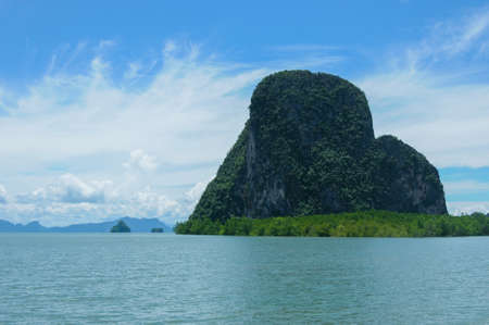 phangnga: Cliffs Along the Bay surrounded by Islands with Mangroves. Islands at Phang Nga Bay near Krabi and Phuket. Thailand. Stock Photo
