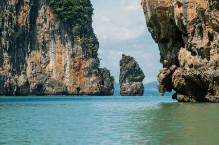 reds: The Ochre Colours of the Rock Glow in Reds and Browns. Islands at Phang Nga Bay near Krabi and Phuket. Thailand.
