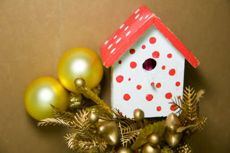 bird house christmas tree decorations on a brown background with christmas balls and other decorations - Bird House Christmas Decoration