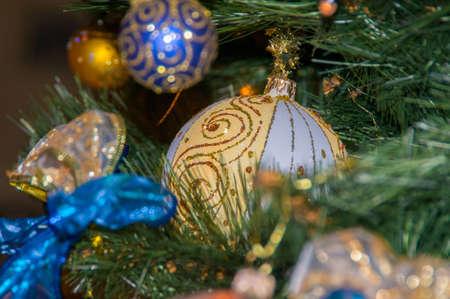 christmastide: Christmas Balls and Christmas-Tree Decorations on a Christmas-Tree Branch