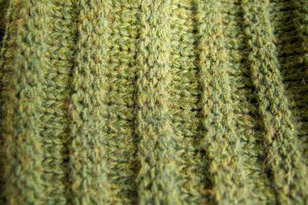 counterpane: Knit texture of green natural wool knitted fabric with cable pattern as background. Stock Photo