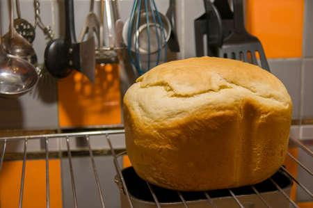 stuff: Rustic homemade bread on kitchen stuff background.
