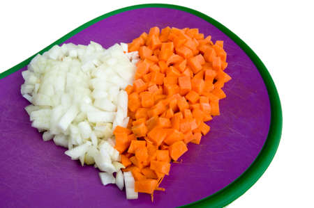 diced: Carrot and onion diced closeup in the shape of heart Stock Photo