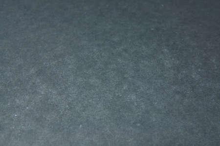 dark gray: Textured dark gray background. Stock Photo