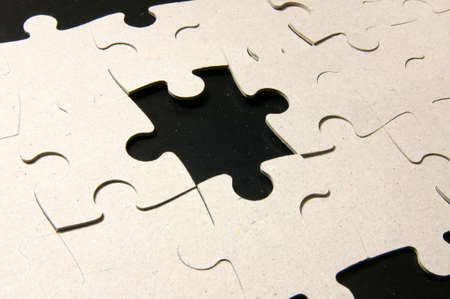 reverse: Reverse beige side of puzzles on black background. Photo contains the work path. Stock Photo
