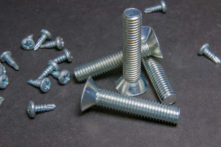 silvery: Silvery four bolts and pile screws on grey. Right upright bolt with triangle bolt.