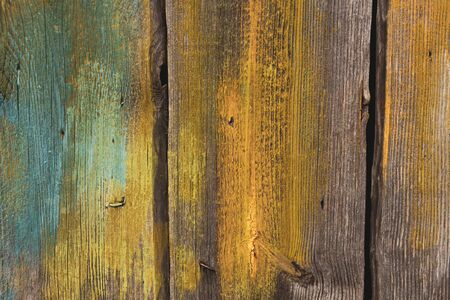 The surface of the old rough pine planks. Partially painted, nails visible. Imagens
