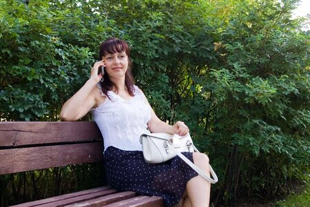 Middleaged woman talks on the mobile phone photo