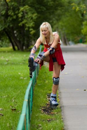 a adult woman ride rollerblades in the park photo