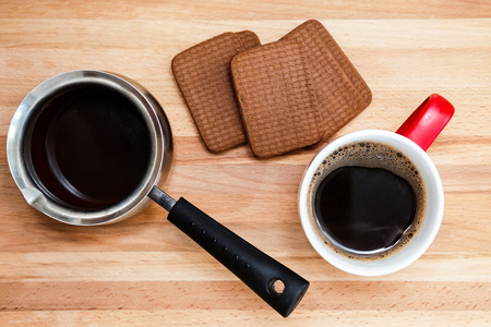 making coffee: Coffee into cup, coffee maker, sweet cookie