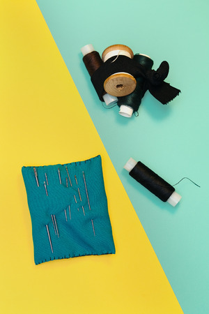 alterations: Set home seamstresses, thread and needles, blue and yellow background
