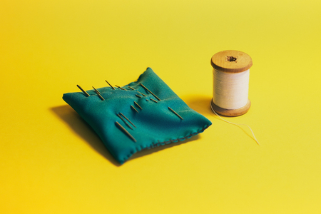 alterations: Set home seamstresses, thread and needles, yellow background